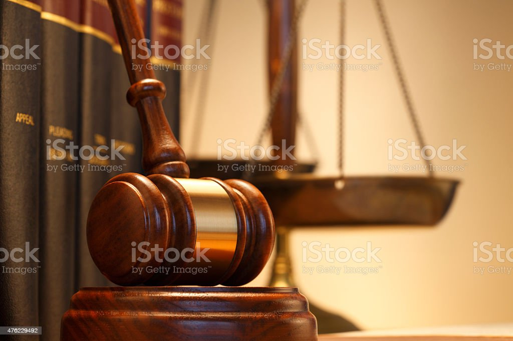 Gavel In Front OF Law Books And Justice Scale stock photo