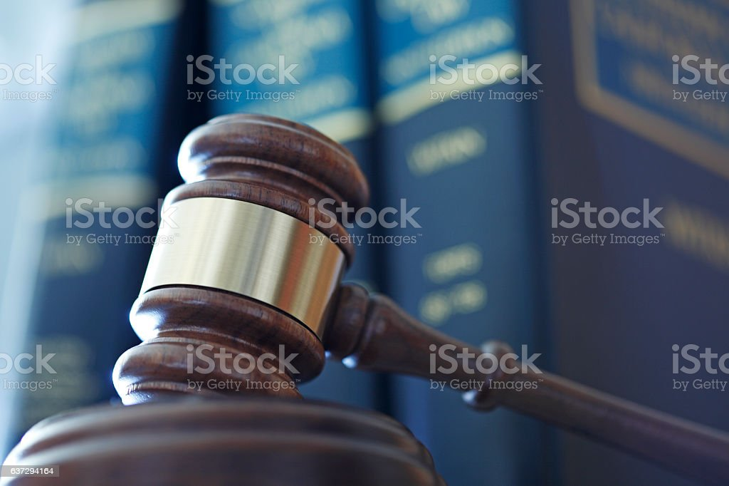 Gavel In Front Of Row Of Law Books royalty-free stock photo