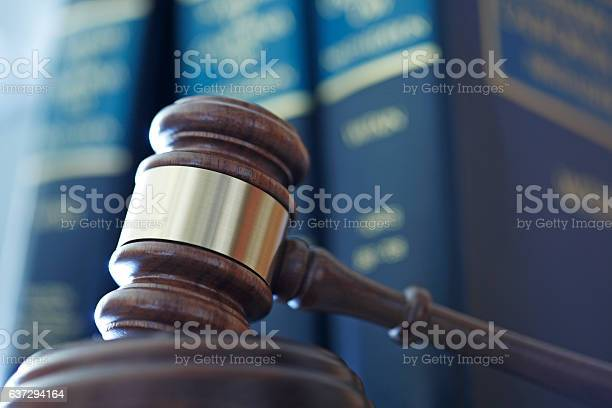 Gavel In Front Of Row Of Law Books Stock Photo - Download Image Now