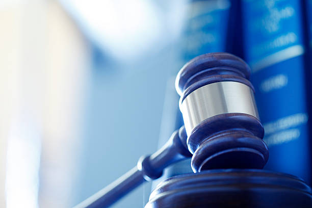 Gavel In Front Of Row Of Law Books stock photo