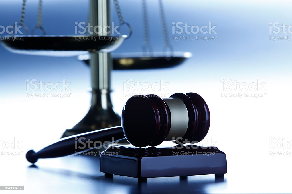 Gavel in front of scales of justice stock photo