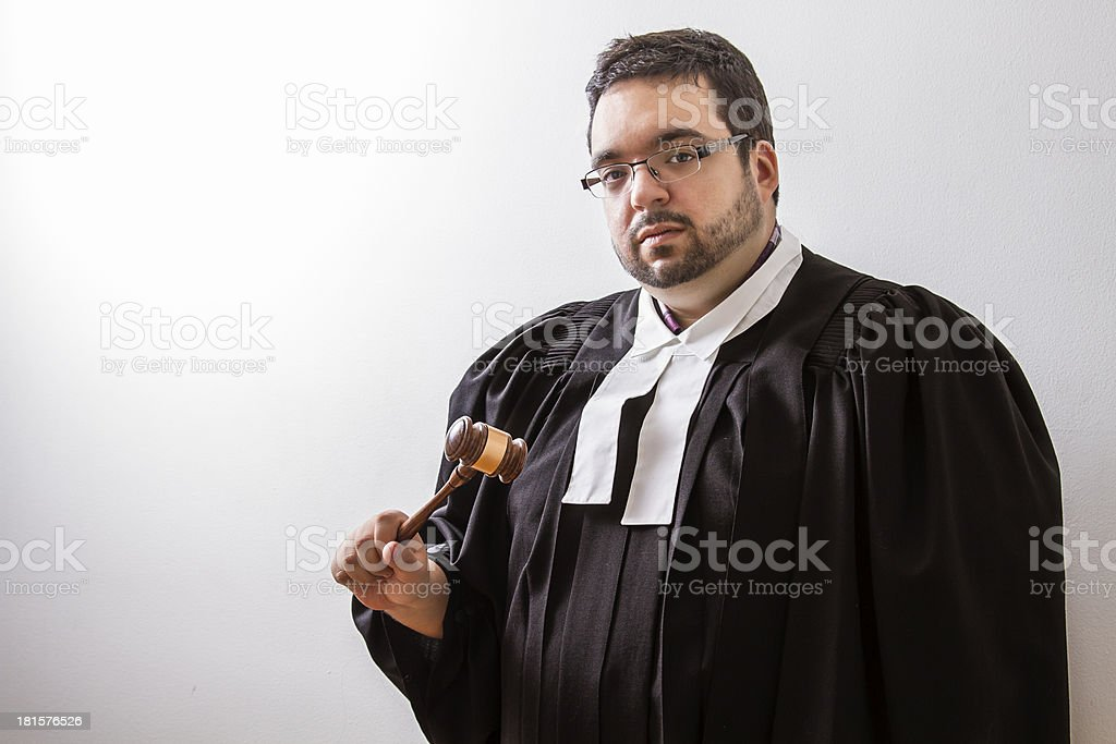 Gavel in hand royalty-free stock photo