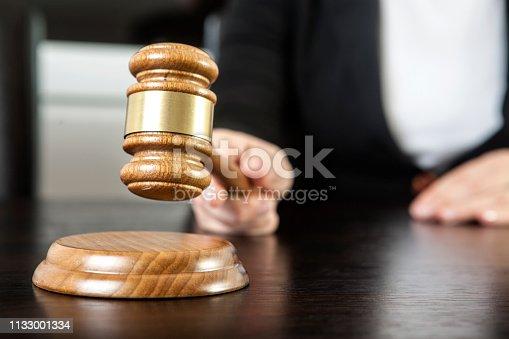 Caucasian woman holding gavel