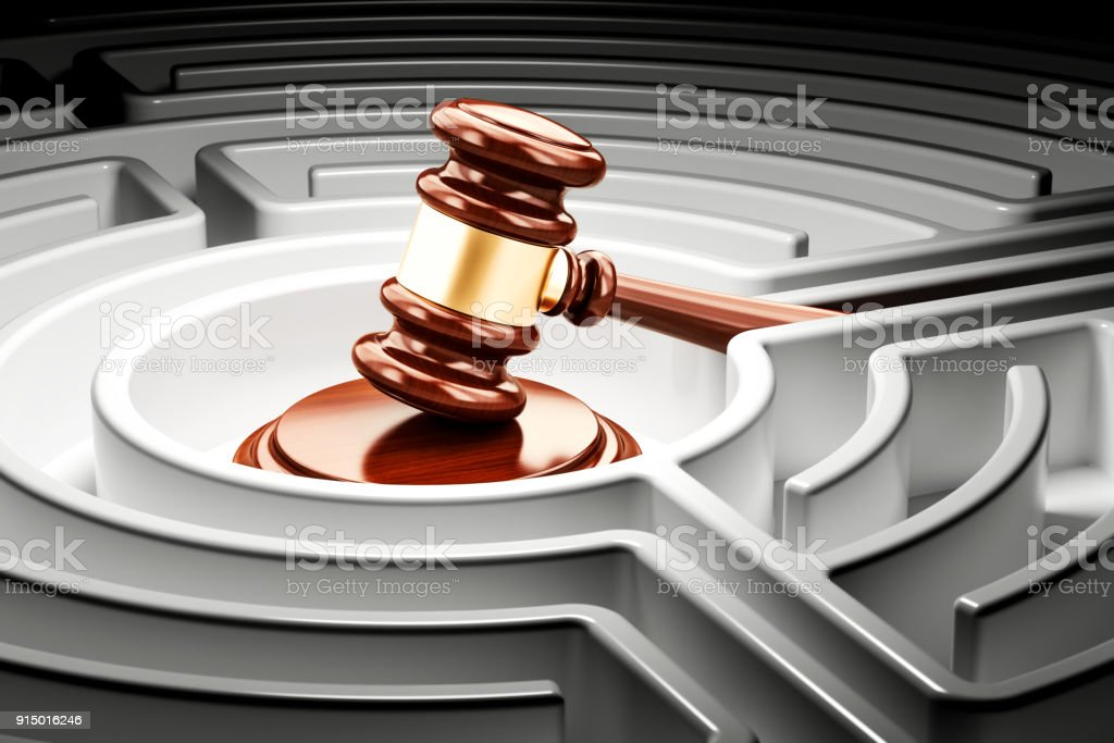 Gavel inside labyrinth maze. 3D rendering stock photo