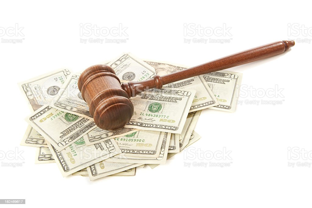 Gavel laying on top of money isolated royalty-free stock photo