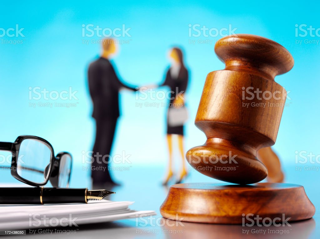 Gavel, Mallet with a Businessman and Women royalty-free stock photo