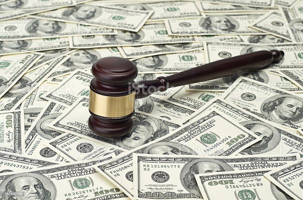 gavel on dollar background royalty-free stock photo