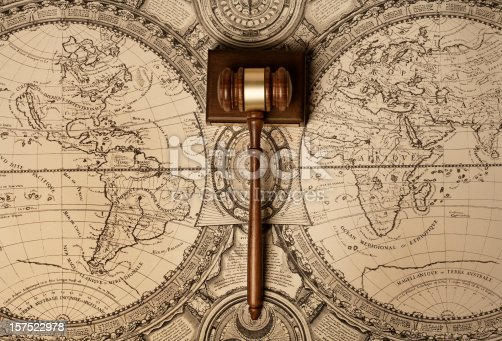 Gavel of justice on old world map