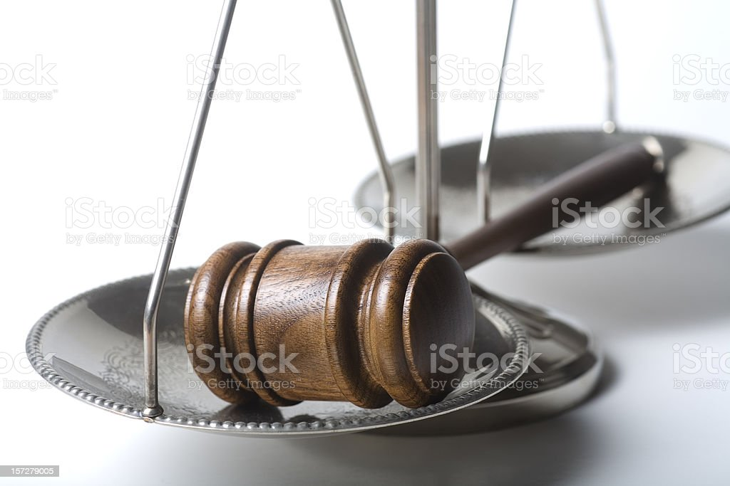 Gavel on silver scale of justice royalty-free stock photo