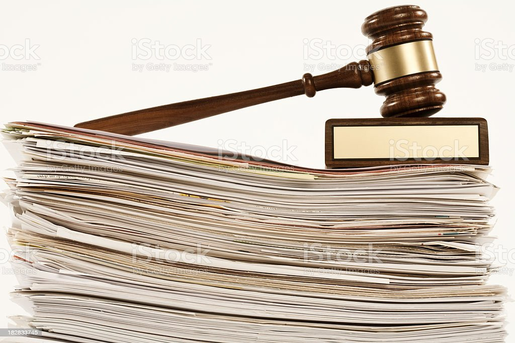 gavel on stack of documents stock photo
