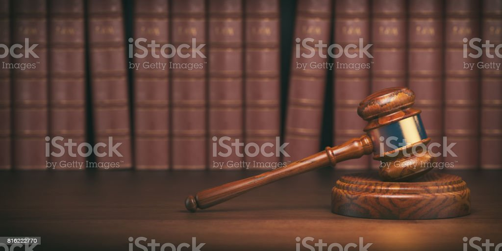 Gavel on the background of vintage lawyer books. Concept of law and justice. stock photo