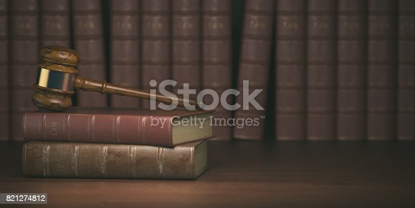 istock Gavel on the background of vintage lawyer books. Concept of law 821274812