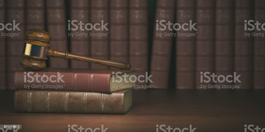 Gavel on the background of vintage lawyer books. Concept of law stock photo