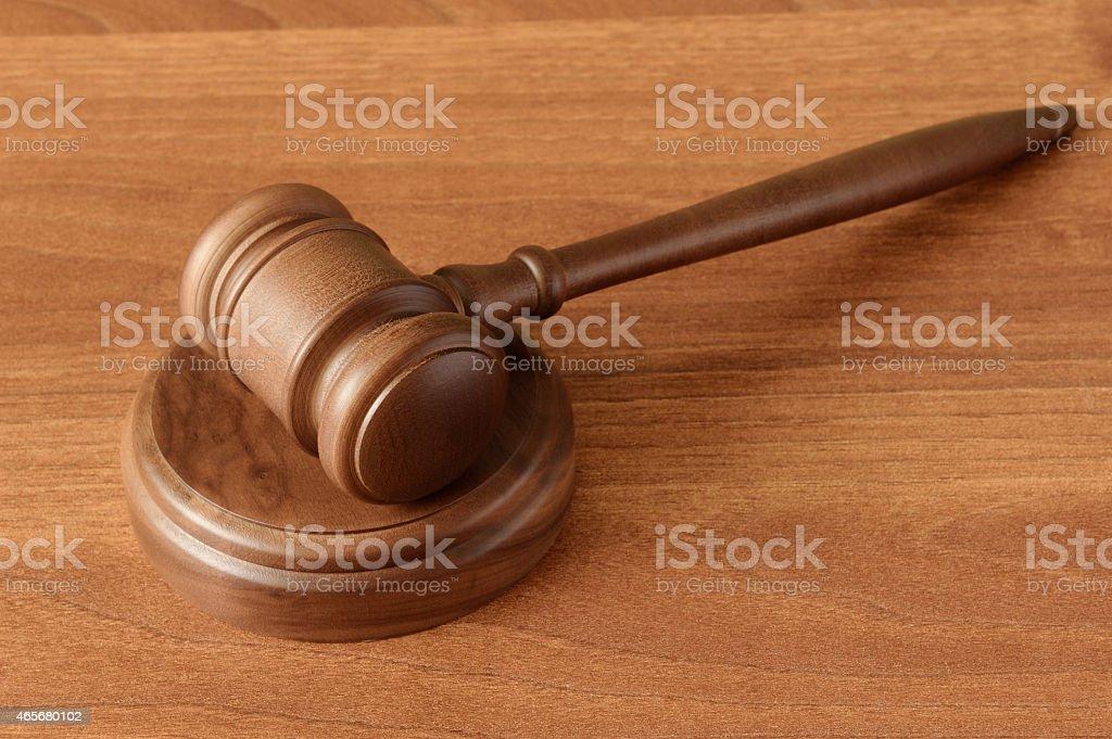Gavel on wood surface stock photo