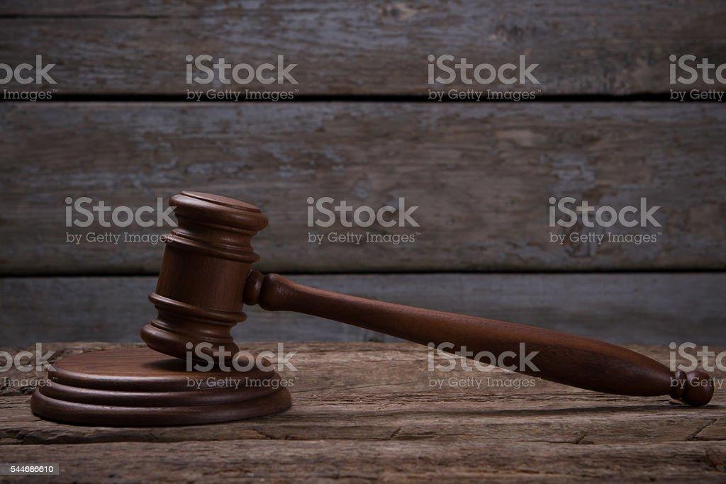 Gavel on wooden background. stock photo