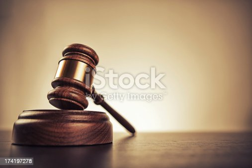Gavel on desk. Isolated with good copy space. Dramatic lighting.