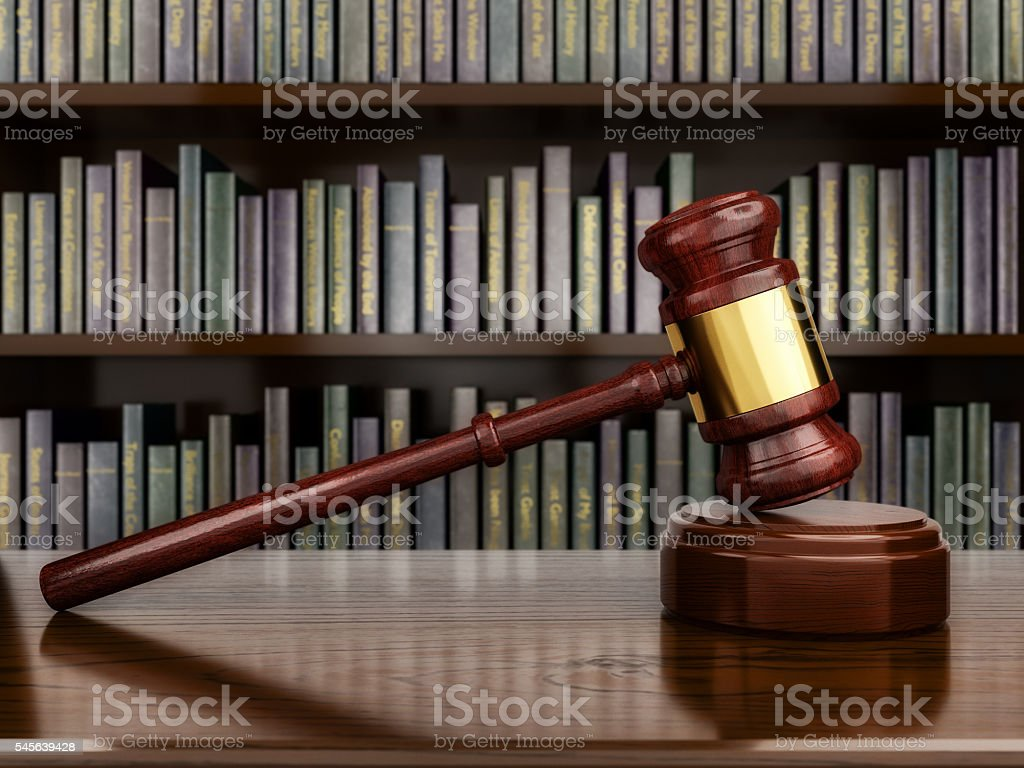 Gavel Resting in front of Law Books - 3D Illustration stock photo