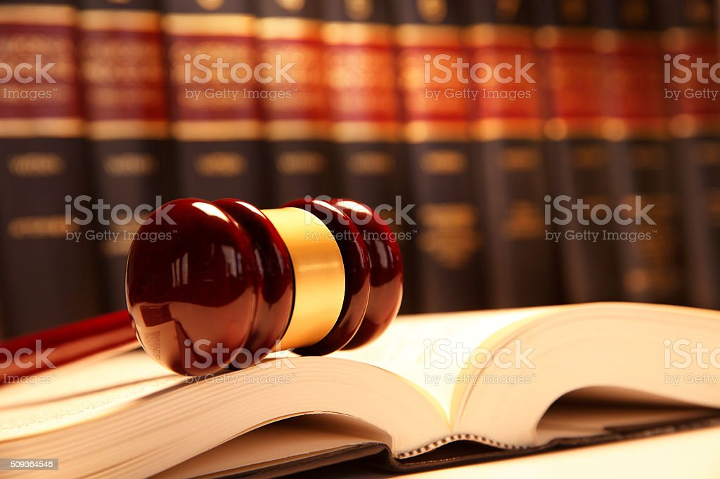 Gavel Resting On Top Of Open Law Book stock photo