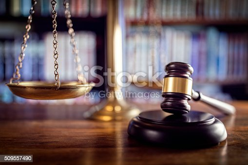 istock Gavel, scales of justice and law books 509557490