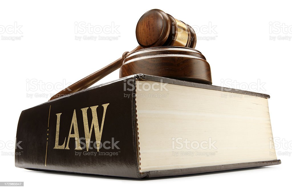 Gavel sitting on top of law book on white background royalty-free stock photo
