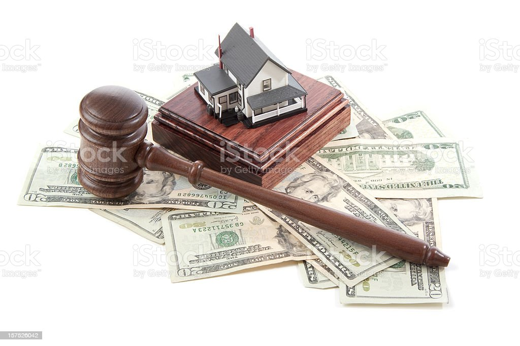 Gavel, sound block and money with model house on white stock photo