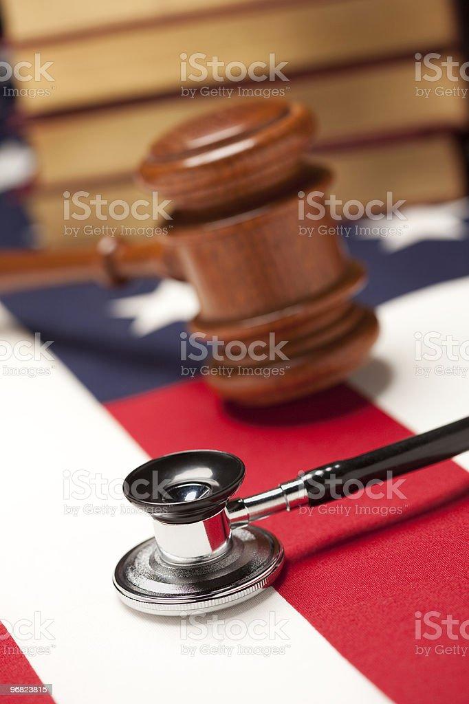 Gavel, Stethoscope and Books on Flag royalty-free stock photo