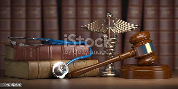 istock Gavel, stethoscope and caduceus sign on books background. Mediicine laws and legal, medical jurisprudence. 1060150840
