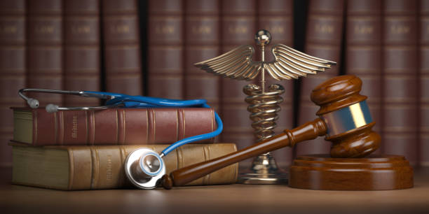 Gavel, stethoscope and caduceus sign on books background. Mediicine laws and legal, medical jurisprudence. stock photo