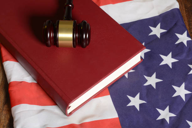 Gavel with law book on American flag Gavel with law book on American flag. green card stock pictures, royalty-free photos & images