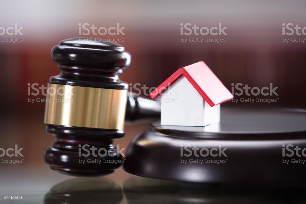 Gavel With Small House Model stock photo