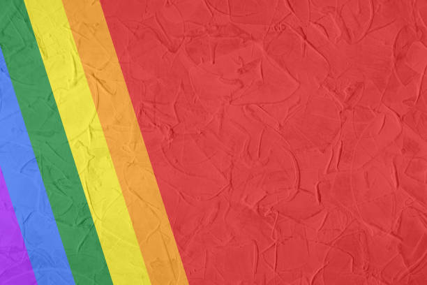 Gay and LGBTQ rainbow flag. Culture symbol. Handmade. Textured, made with acrylic paint and canvas. Grunge, isolated on white. photo gay pride parade stock pictures, royalty-free photos & images