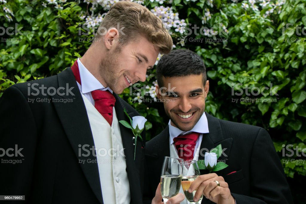 Gay Couple At Wedding Reception Toast Being Married Stock Photo