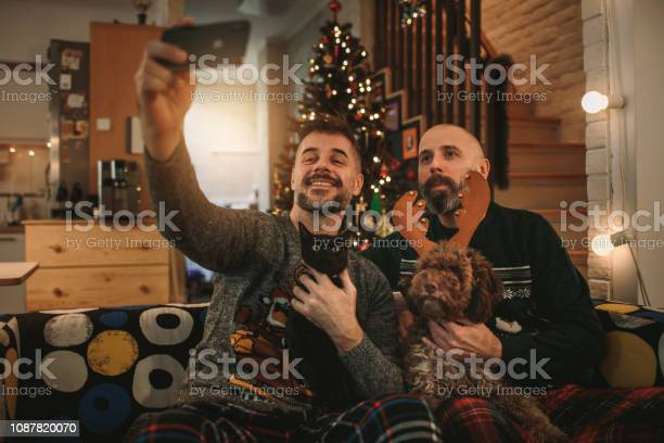 Gay couple celebrating christmas picture id1087820070?b=1&k=6&m=1087820070&s=612x612&h=wqw3wlbh7bnncbb qzi3wbzo uzb6f1lwo63n5jwsjg=