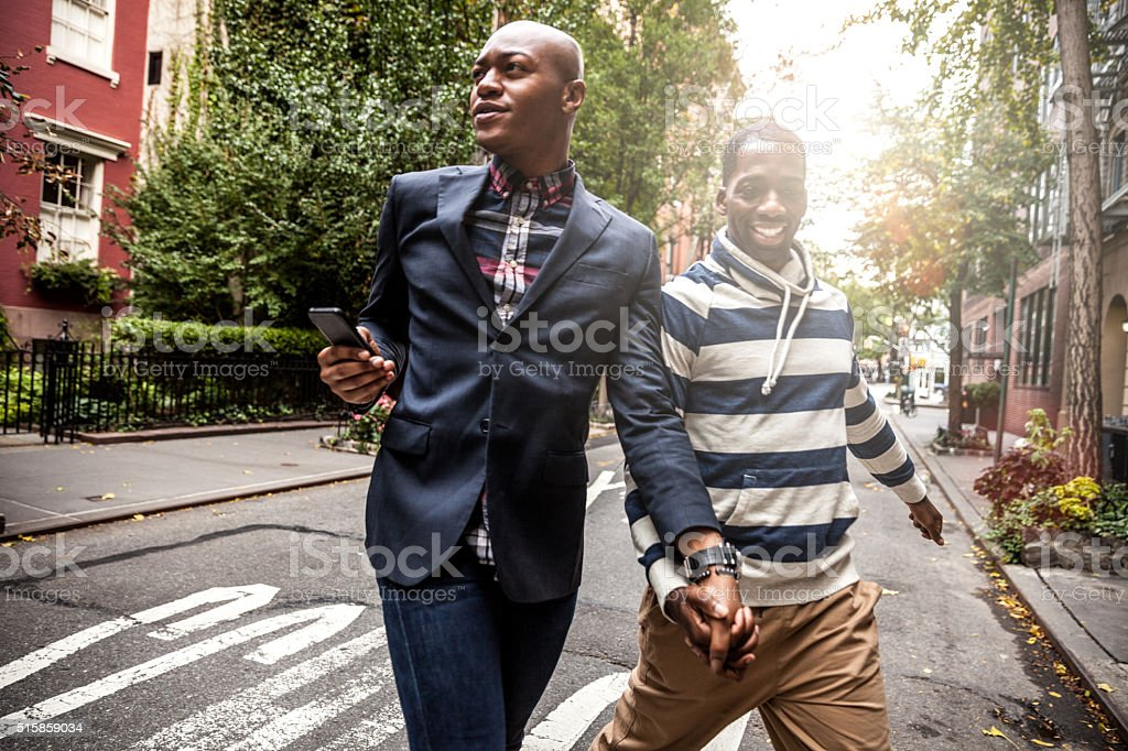 Gay couple crossing the street Greenwich Village - NY stock photo