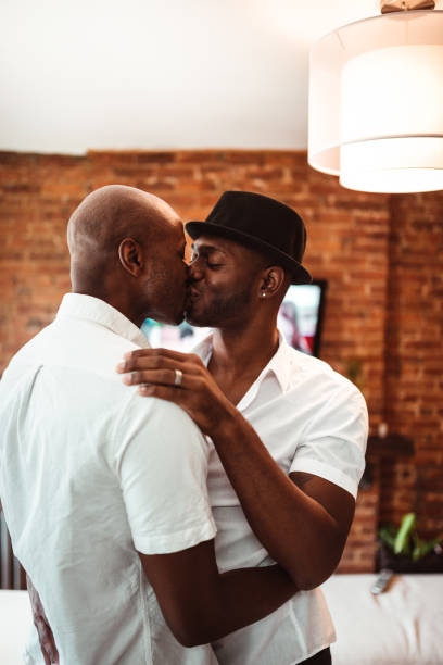Black Gay Men Kissing Stock Photos, Pictures & Royalty