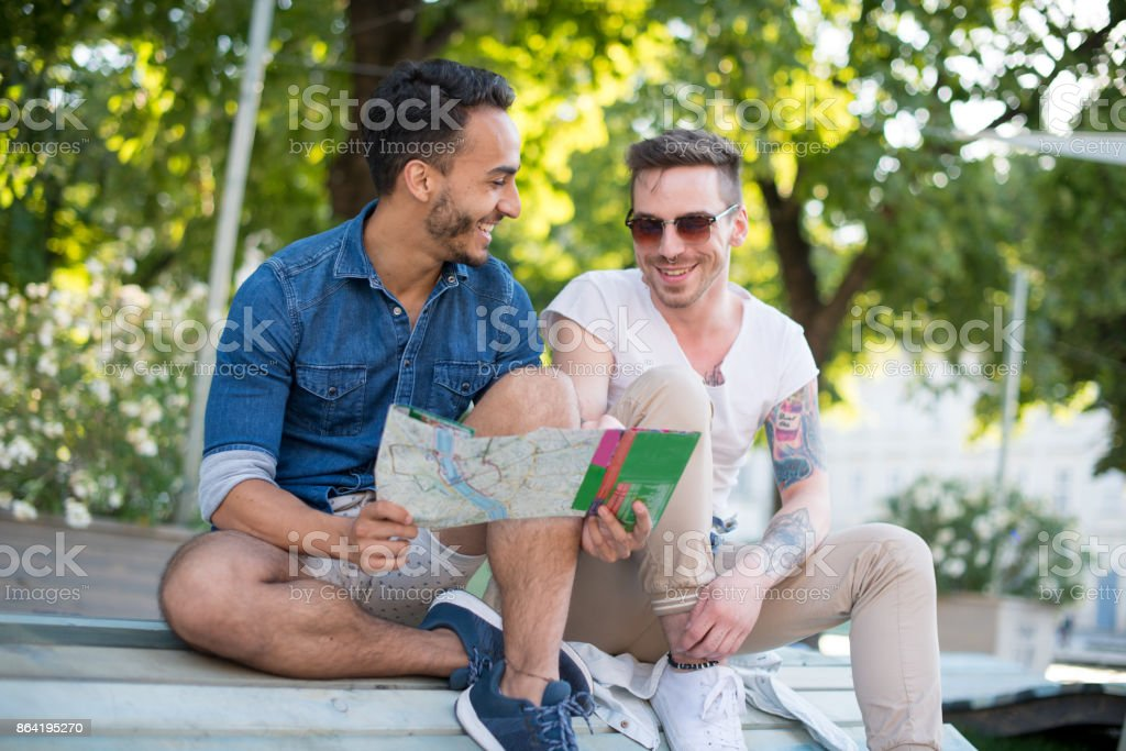 Gay couple discovering city and its landmarks royalty-free stock photo