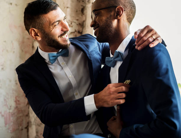 Gay couple embracing each other Gay couple embracing each other gay person stock pictures, royalty-free photos & images