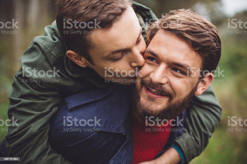 Gay couple having fun outdoor. stock photo
