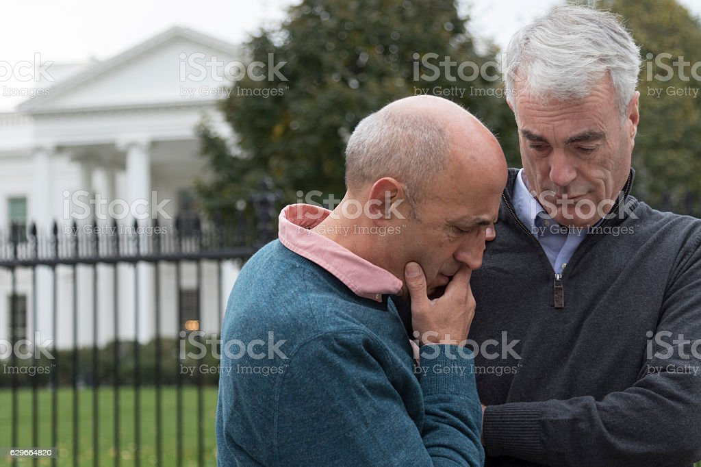 Gay Couple Looking Distraught In Front of White House stock photo