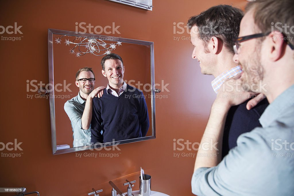 Gay couple looking in mirror royalty-free stock photo