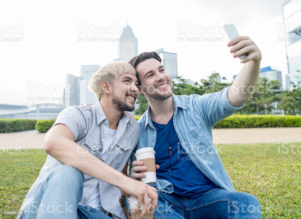 Gay couple taking a selfie royalty-free stock photo