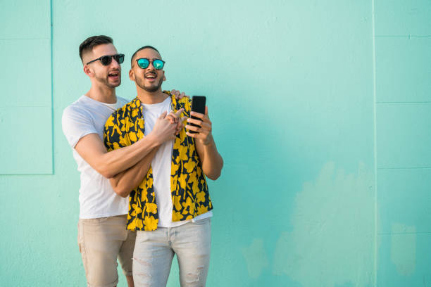 Gay couple taking a selfie with mobile phone. stock photo