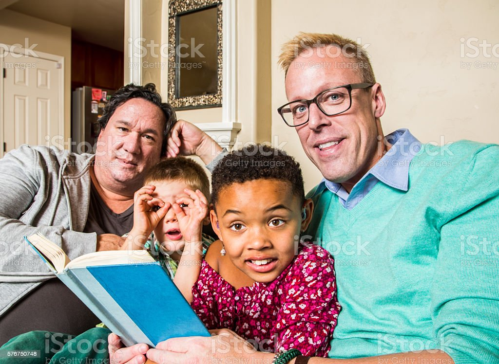Gay Family Reading Together stock photo