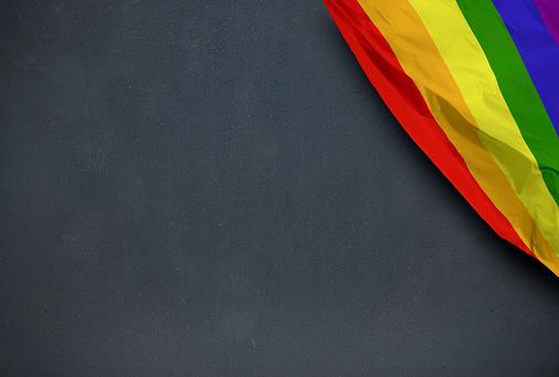 Gay flag on blackboard background