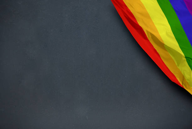 Gay flag on blackboard background stock photo