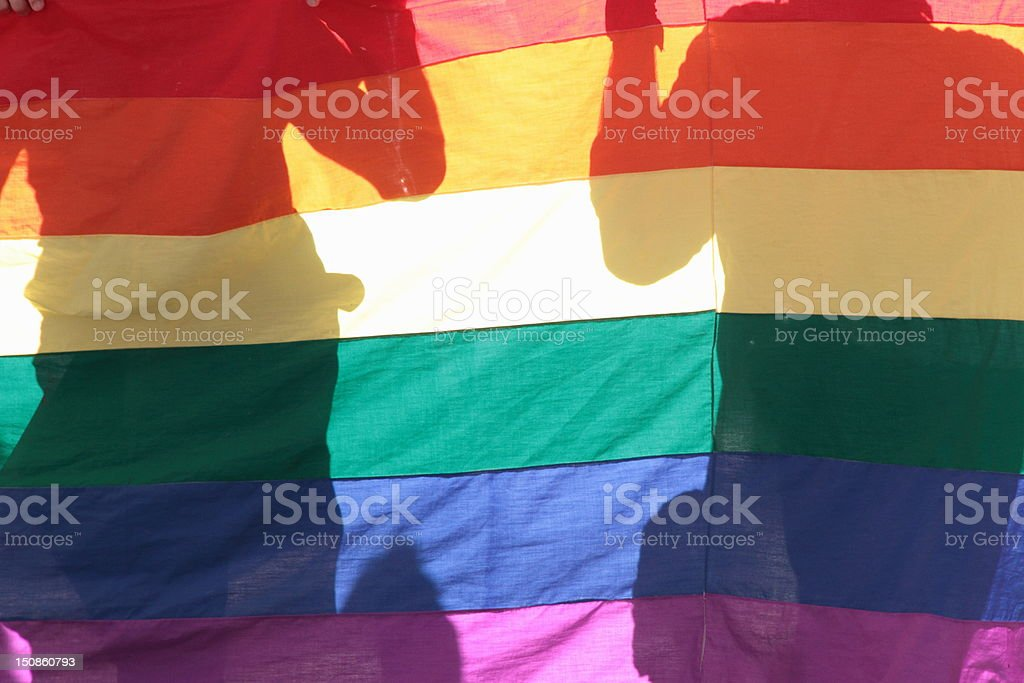 gay flag silhouette stock photo