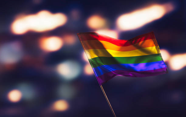 Gay flag waving pridefully Gay flag waving with pride lgbtqi pride event stock pictures, royalty-free photos & images
