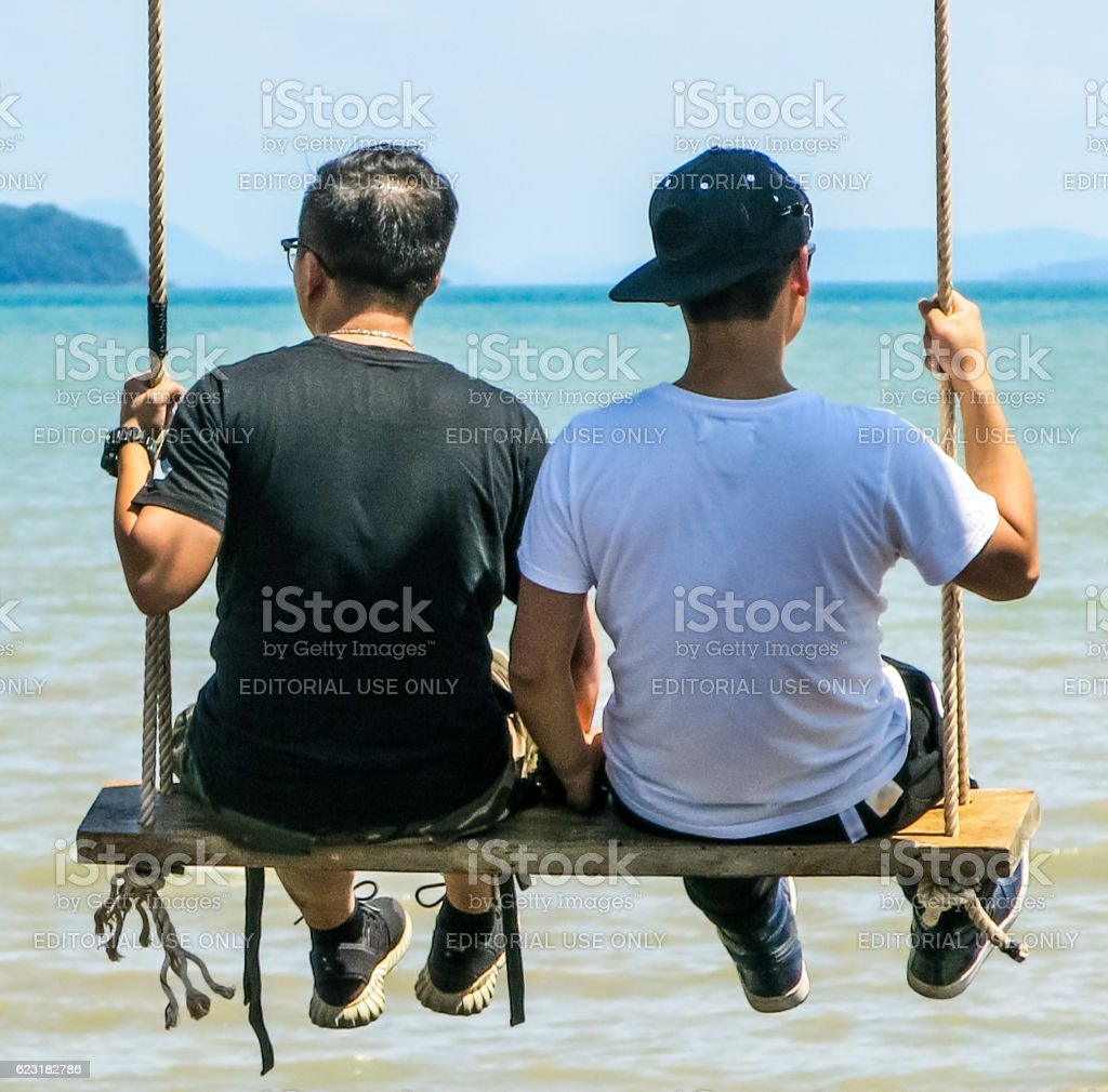 Gay LGBT Couple Relaxed Swing Vacation Asia – Foto