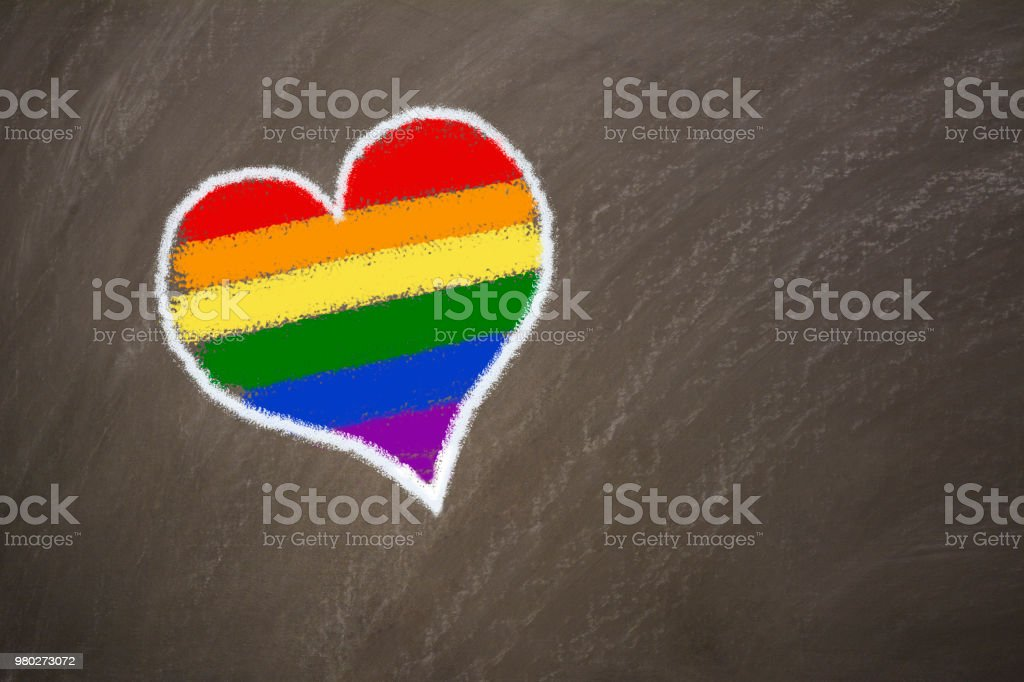 Gay lgbt flag painted rainbow heart on a black chalkboard