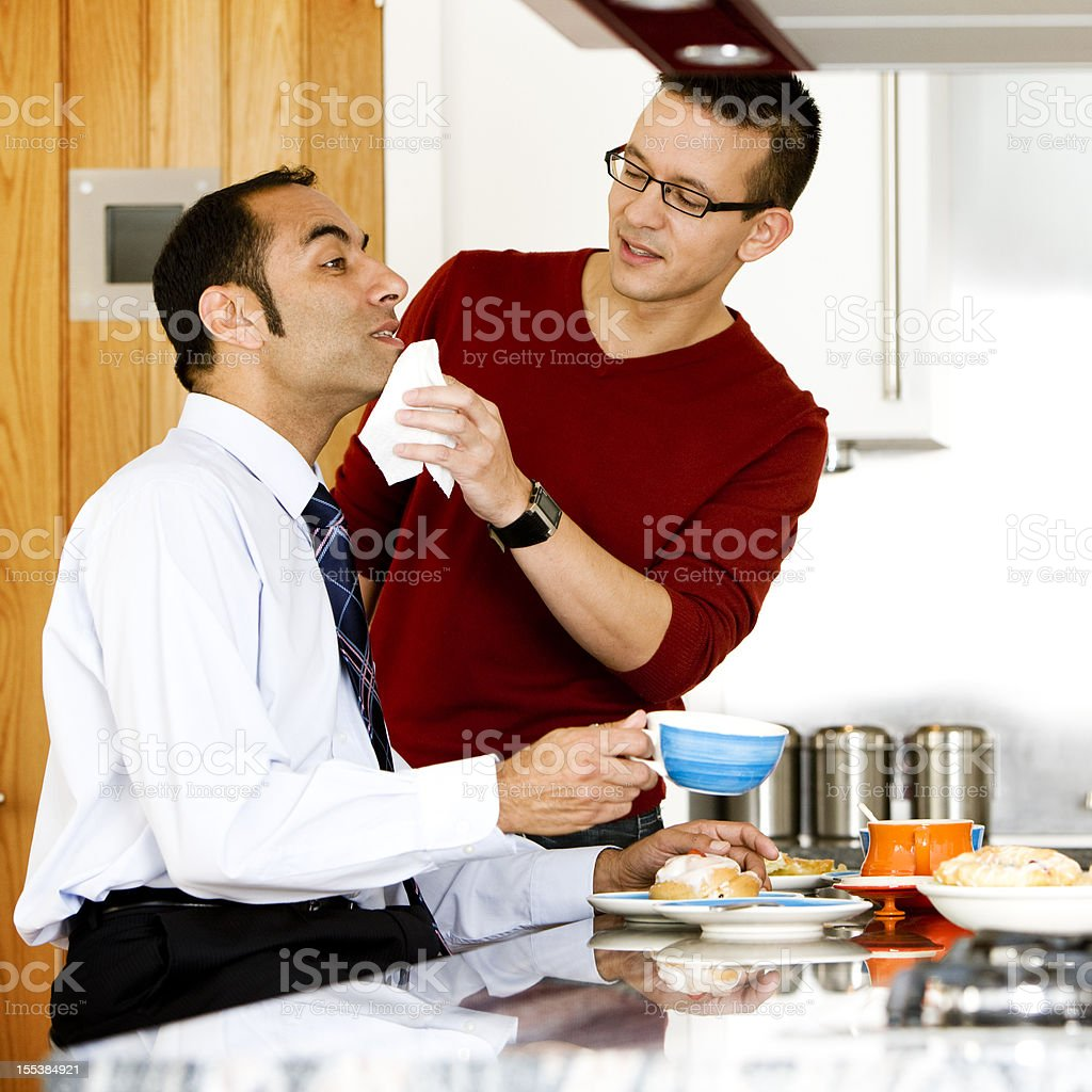 gay lifestyle: fussing over breakfast stock photo